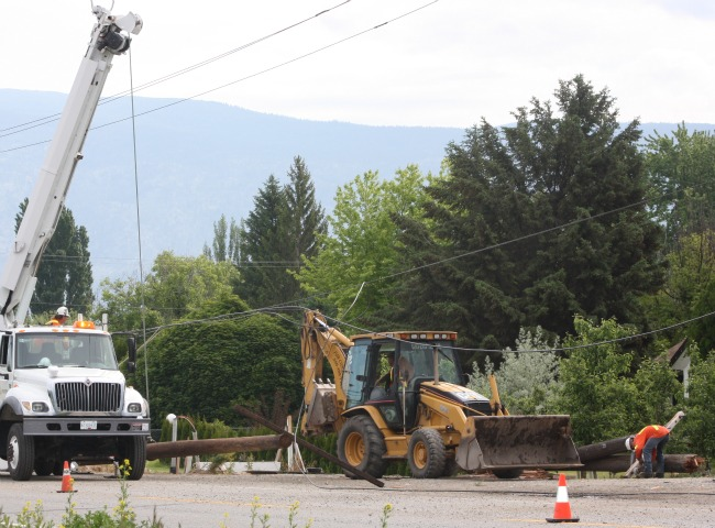Sheared off pole causes power outages