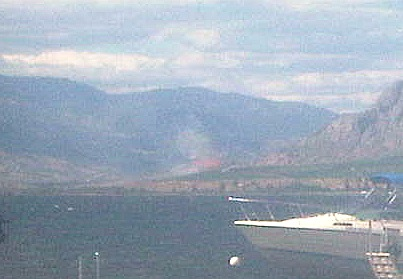 Flames from grass fire seen for miles